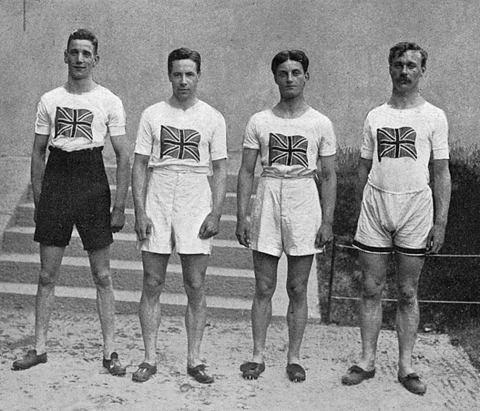 The English 4 x 100 metres relay team who won gold medals at the Stockholm Olympics in 1912. From left to right: D. Jacobs, H. M. Macintosh, W. R. Applegarth and V. D'Arcy. Note the high-waisted shorts and T-shirts emblazoned with a Union Jack. Date: 1912