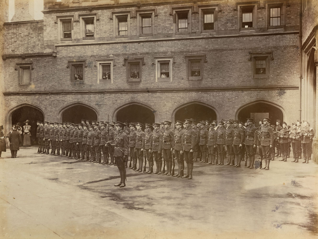 Lord Roberts, former Commander-in-Chief of the British Army and recipient of the Victoria Cross during the Indian Mutiny, visits Rugby School in February 1906 where he inspects the school's Rifle Club (OTC, Officer Training Corps). The officer in charge of the corps is 2nd Lieutenant Rupert Brooke, poet, who would die in the Aegean during the First World War. Date: 1906
