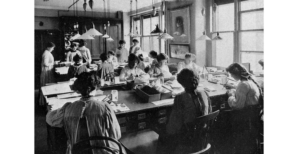 The designing room at Raphael Tuck & Sons, fine art publishers of prints, cards, Almanacks and postcards, staffed largely by women. Tuck were one of the leading card and postcard publishers in the 19th and 20th centuries. Date: 1903