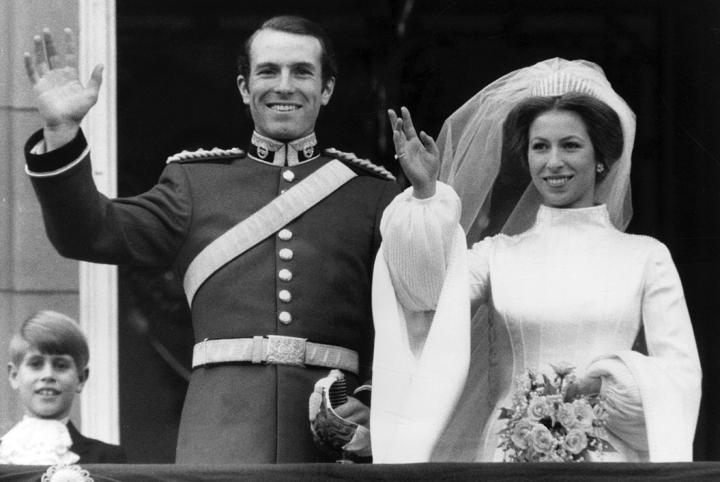 Princess Anne, the Princess Royal seen smiling and waving from the balcony of Buckingham Palace following her marriage to Captain Mark Phillips at Westminster Abbey on 14 November 1973. Prince Edward, now the Duke of Wessex, who served as a pageboy can be seen beside the couple. Date: 1973
