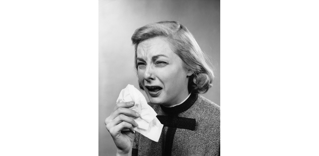 1950s Woman With Handkerchief Sneezing Indoor