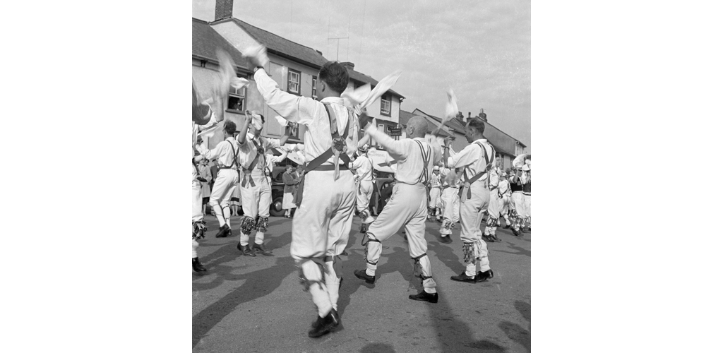 A group of morris men performing a handkerchief dance in Town Street Date: 1948 - 1952