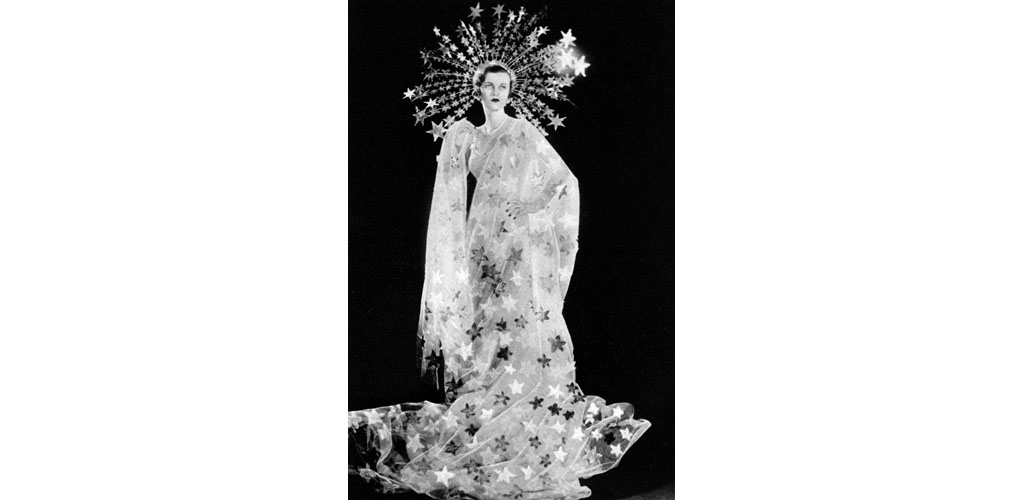 Mrs Charles Sweeny, formerly Miss Margaret Whigham and later the Duchess of Argyll (1912 - 1993), pictured as Astrae, the Star-Maiden for the Olympian Party at Claridges on 5 March 1935 in aid of the Greater London Fund for the Blind. The Olympian Party featured a pageant of Olympians consisting of an entertainment of dancing and singing with orchestral accompaniment. Date: 1935