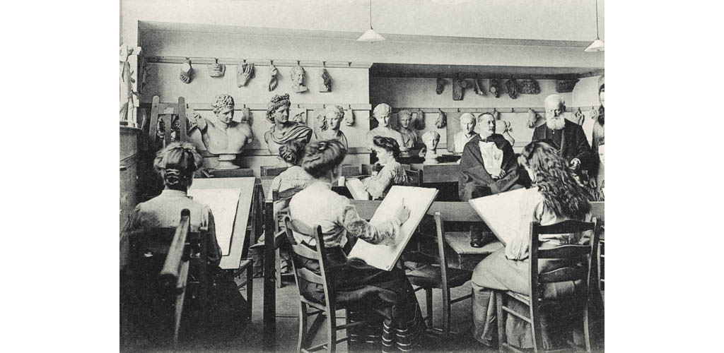 Art Studio - Queen's College, Harley Street. Ladies sketching a model, with the teacher alongside. Various classical busts surround the studio as inspiration and examples of the finest classical form and structure... Some of the women have chosen these to draw instead! Date: circa 1910s