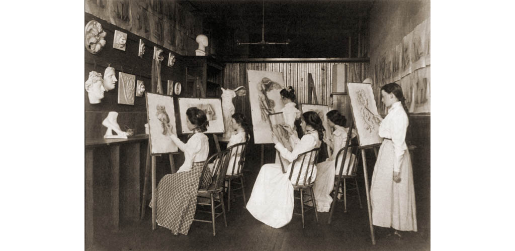 Six girls in art a high school art class drawing plaster casts of classical sculpture. 19th century art training immersed students in classical aesthetics. 1899.