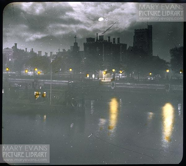 Mary Evans Picture No 10014828 - A view across the river towards Lambeth Palace by night with the moon just disappearing behind clouds