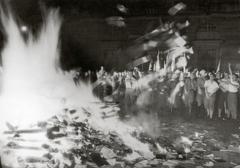 "Book burning on Opernplatz in Berlin (including an appearance by Josef Goebbels). On 10 May 1933 ""undeutsches Schrifttum"" (Un-German literature) was being burned in many German university towns. These macabre events were the highlight of the campaign ""Wider den undeutschen Geist"" (Against the Un-German Spirit) after the National Socialists' coming to power. The book burnings had been arranged by the German Student Association's Main Office for Press and Propaganda.   10 May 1933"