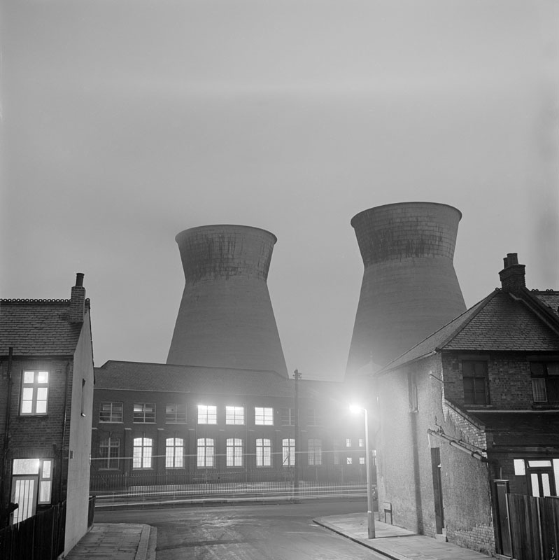 General view of the cooling towers of the power station at Church End, Harlesden at night from the west from Crouch Road, London     Date: 1965