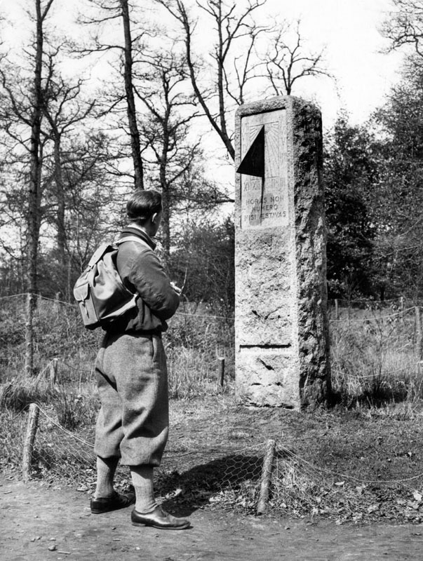 A rambler stops to look at a sundial in Petts Wood, Kent, set up in memory of William Willett, pioneer of 'daylight saving' whose ideas led to British Summer Time.      Date: 1939