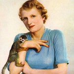 Lady Broughton (1894-1968), the first wife of Sir Jock Delves Broughton with her squirrel monkey, Mr. Winks, whom she brought from British Guiana in 1938.  Previously Miss Vera Griffith-Boscawen, she married Jock in 1913 and divorced him in 1940 (he would go on to marry Diana Caldwell and stand trial for the murder of her lover, Josslyn Hay, Earl of Erroll in Kenya).  Vera travelled widely in South East Asia and was known as a big game hunter and fisherwoman.  She was also a highly regarded photographer of natural subjects.       Date: 1939