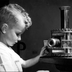 Little boy with an early magic lantern at the exhibition Play and the Child, Delft, Netherlands.     Date: 1953