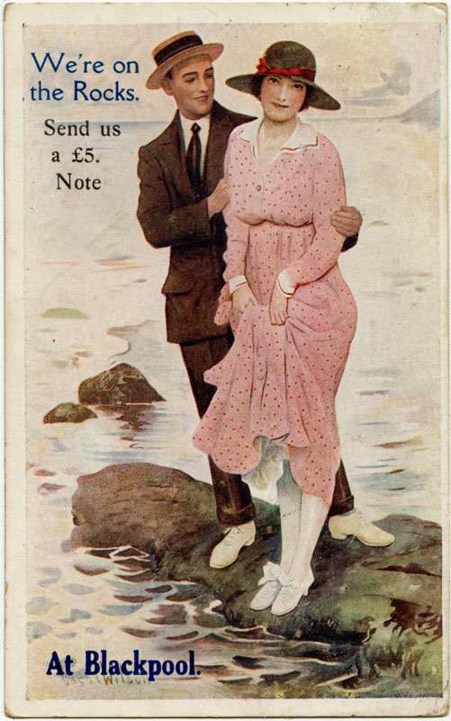 A couple stranded on a rock at Blackpool: 'We're on the rocks. Send us a five pound note.'      Date: 1922