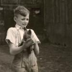 Boy holding a fox cub.   circa 1940s