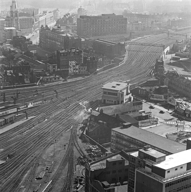 Elevated view looking down onto the tracks leading south out of Waterloo Station and showing the surrounding townscape     Date: 1960 - 1972