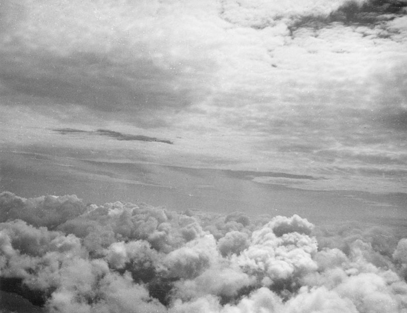 Clouds seen from a pilot's viewpoint.         Date: 1930s