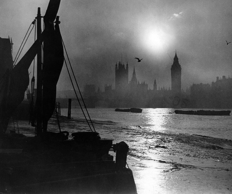 View over the River Thames near Hungerford Bridge in London, looking towards Westminster.   1930s
