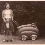Mother and her son with a streamlined pram - Classic 1950s German design.     Date: circa early 1950s