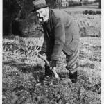 Countryman digging with a spade.   circa 1930