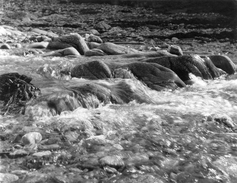 A fresh water stream running into the sea, Port Quin, Cornwall, England.       Date: 1960s