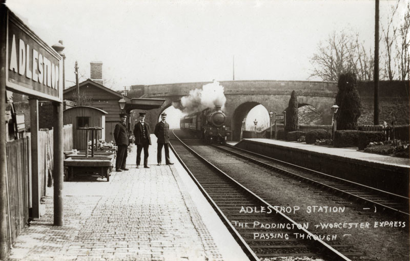 The railway station at Adlestrop, Gloucestershire. Station staff stand on the platform while the Paddington-Worcester Express steams towards the station. The location was immortalised by Edward Thomas in his poem 'Adlestrop'.  early 20th century