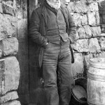 Octogenarian Skye crofter outside his cottage, Scotland.      Date: late 19th century