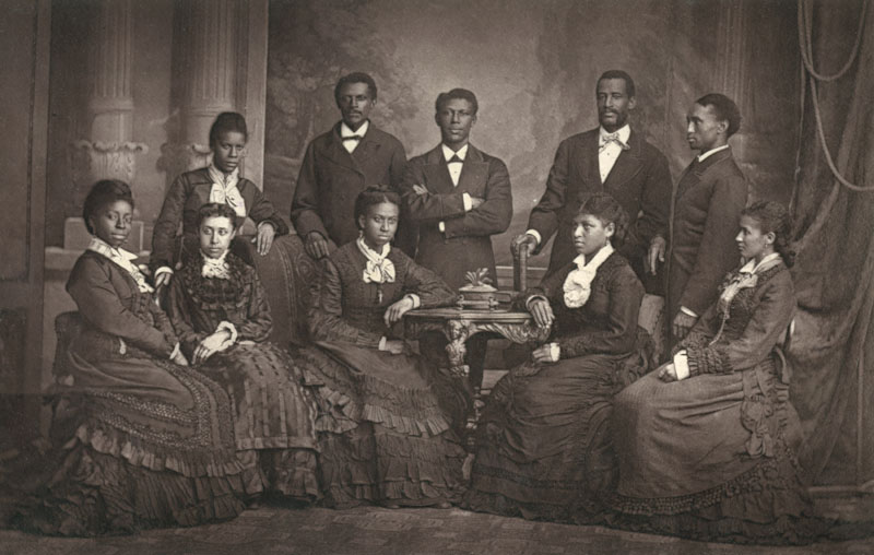 Group photo of the Jubilee Singers of Fisk University, Nashville, Tennessee, USA. They were an African-American a cappella ensemble who toured and performed to raise money for their college which was in danger of closing due to lack of funds. The singers pictured here are: Maggie Porter, E.W. Watkins, H.D. Alexander, F.J. Loudin, Thomas Rutling, Jennie Jackson, Mabel Lewis, Ella Sheppard, Maggie Carnes and America W. Robinson.     Date: 1870s