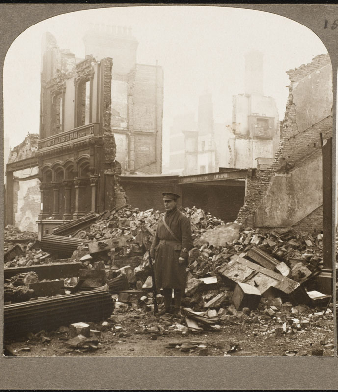 Guarding the remains of the  Ulster and Leinster Bank in  Dublin, destroyed by rebels in  the Easter Rising       Date: 1916
