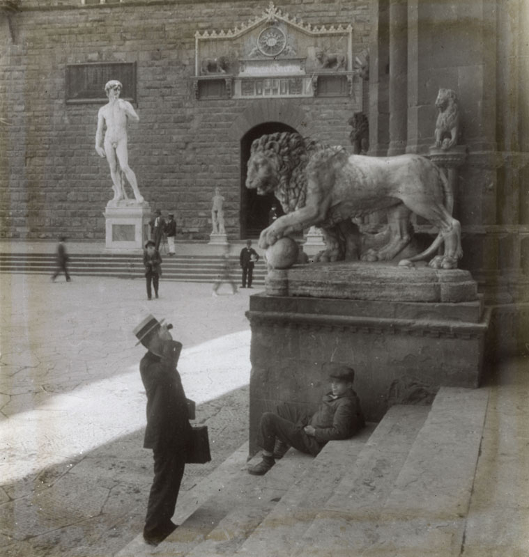 Piazza della Signoria, Florence, Italy, with Michelangelo's statue of David on the left, and a lion on the right.      Date: circa 1890s